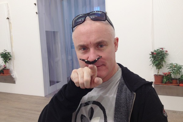 Damien Hirst with butterfly