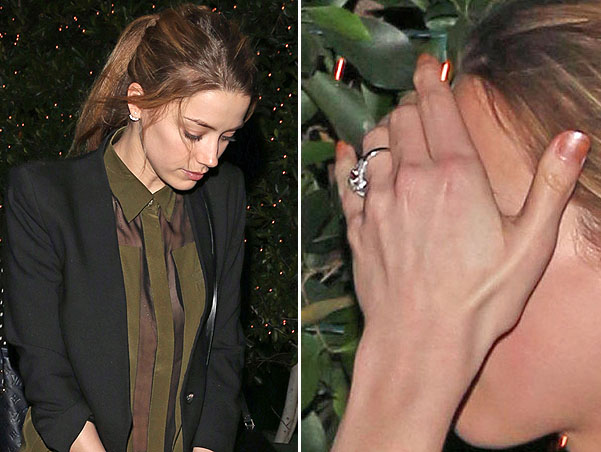 A bashful Amber Heard keeps her head down after dinner at Ago